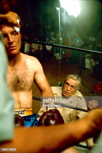 View of American actor Stacy Keach as film director John Huston watches on the set of their film 'Fat City,' Stockton, California, 1972.