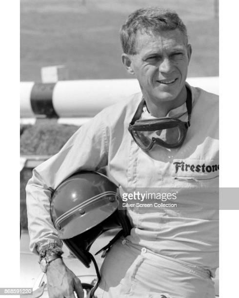 View of American actor Steve McQueen in Firestone racing suit at Riverside Raceway Riverside California July 1966