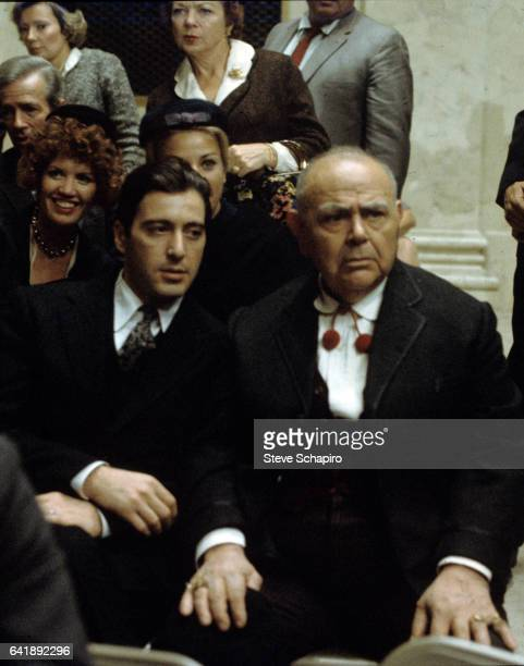 View of American actors Al Pacino and Salvatore Po as they sit together in a scene from the film 'The Godfather Part II' 1974