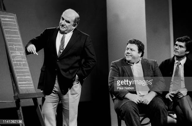View of American actors from left Ed Asner George Wendt and Fred Willard as they perform onstage during the Second City 25th Anniversary performance...