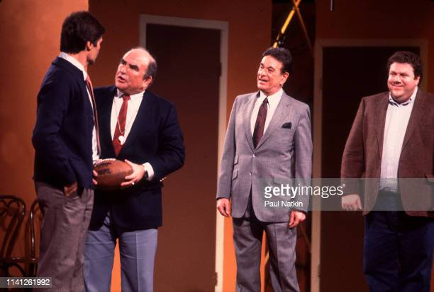 View of American actors from left Fred Willard Ed Asner Shelley Berman and George Wendt as they perform onstage during the Second City 25th...