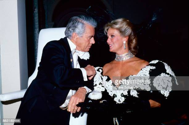 View of American actors John Forsythe and Linda Evans on the set of the television series 'Dynasty' 1980s