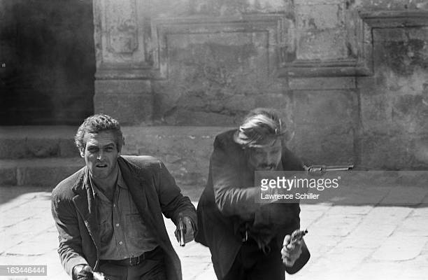View of American actors Paul Newman and Robert Redford during a take of the final scene of their film 'Butch Cassidy and the Sundance Kid' Cuernavaca...