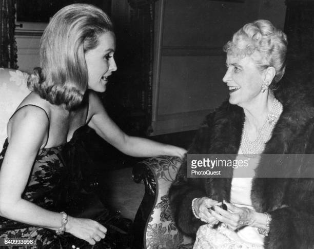 View of American actress and heiress Dina Merrill talks with her mother socialite Marjorie Merriweather Post at an unspecified event Washington DC...