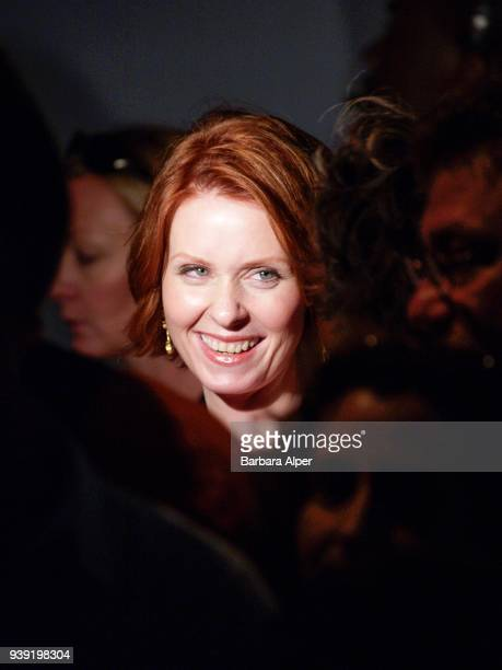 View of American actress Cynthia Nixon as she attends the Badgley Mischka Spring 2004 Fashion Show in a tent at Bryant Park New York New York...