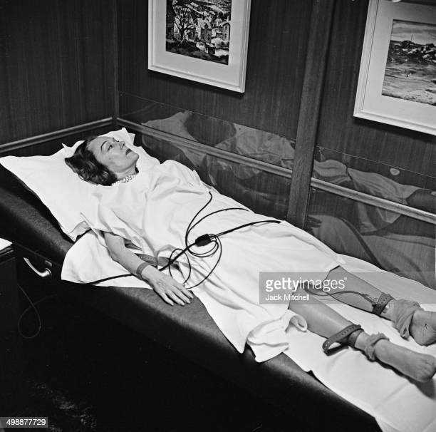 View of American actress Gloria Swanson at her doctor's office for an electrocardiogram New York New York 1960