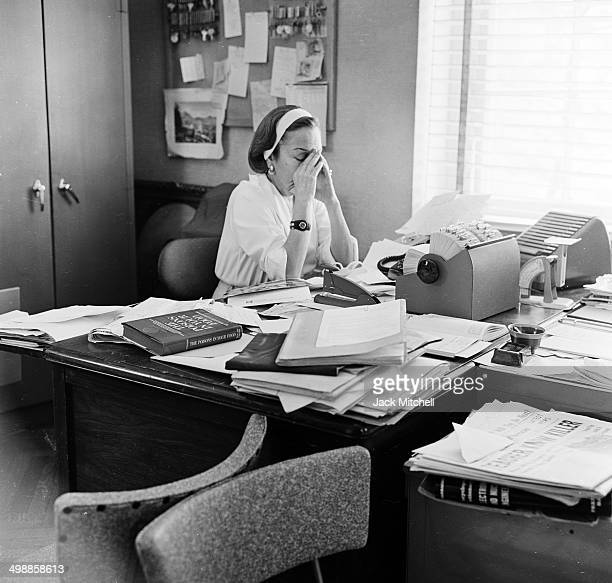 View of American actress Gloria Swanson in her office at the Puritan Dress Company which produced her signature line of women's wear New York New...