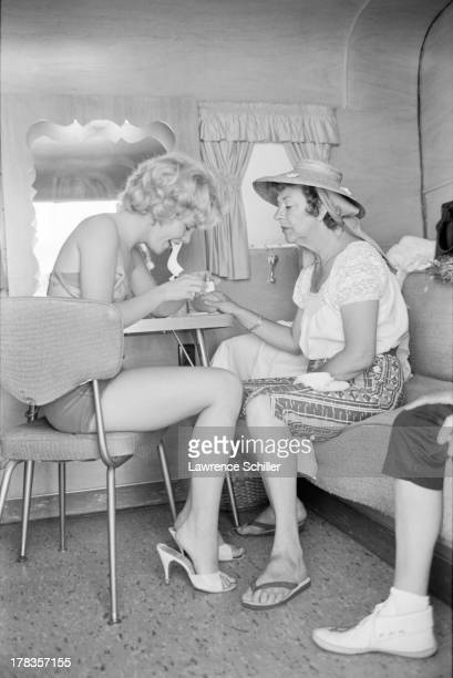 View of American actress Tuesday Weld and an unidentified woman in a trailer during the production of her film 'Soldier in the Rain' Fort Ord...