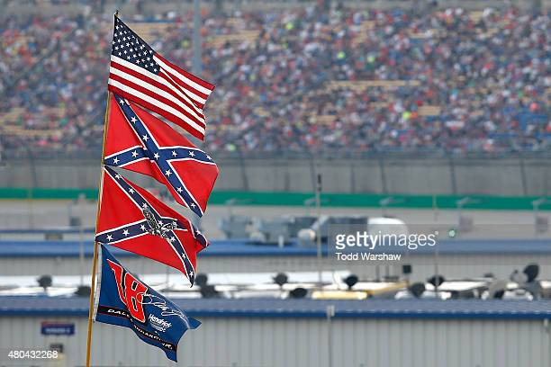 View of American and Confederate flags seen flying over the infield during the NASCAR Sprint Cup Series Quaker State 400 presented by Advance Auto...