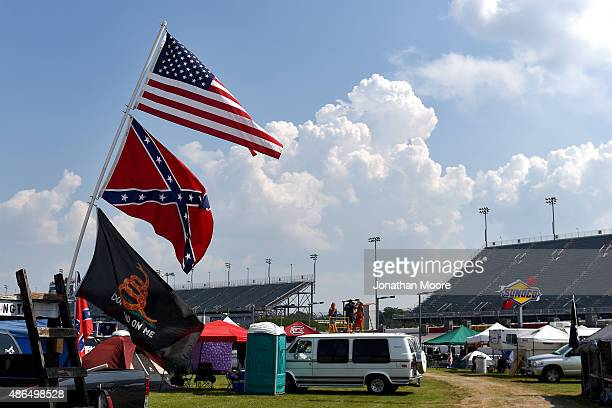 View of American and Confederate flags seen flying over the infield during practice for the NASCAR XFINITY Series VFW Sport Clips Help A Hero 200 at...