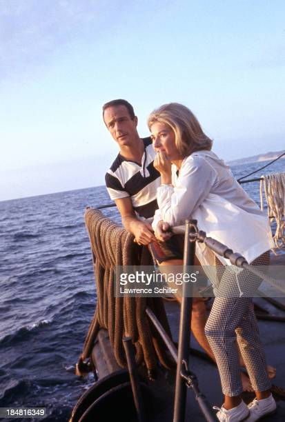 View of American aquanaut Scott Carpenter and his wife Rene as they stand together after his mission aboard Sealab II off the coast of La Jolla...