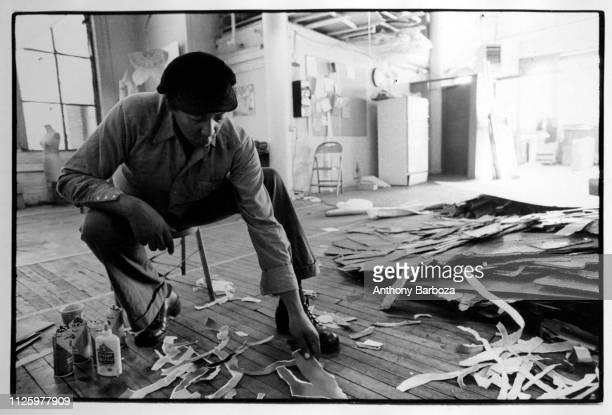 View of American artist Al Loving at work in his studio New York 1980s