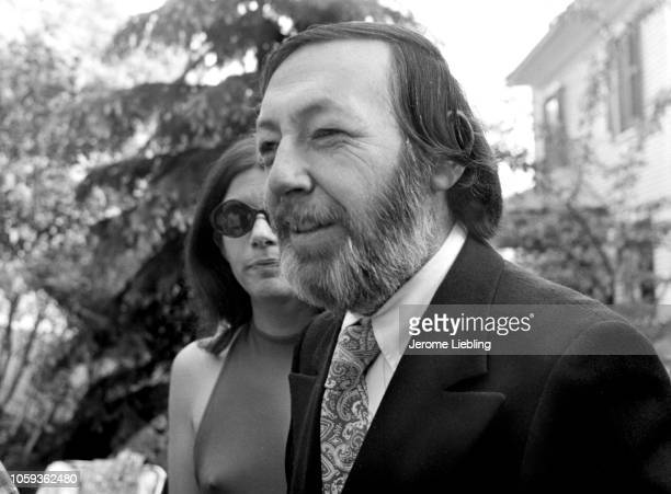 View of American artist and teacher Leonard Baskin as he attends a garden party with unidentified others Amherst Massachusetts May 1972