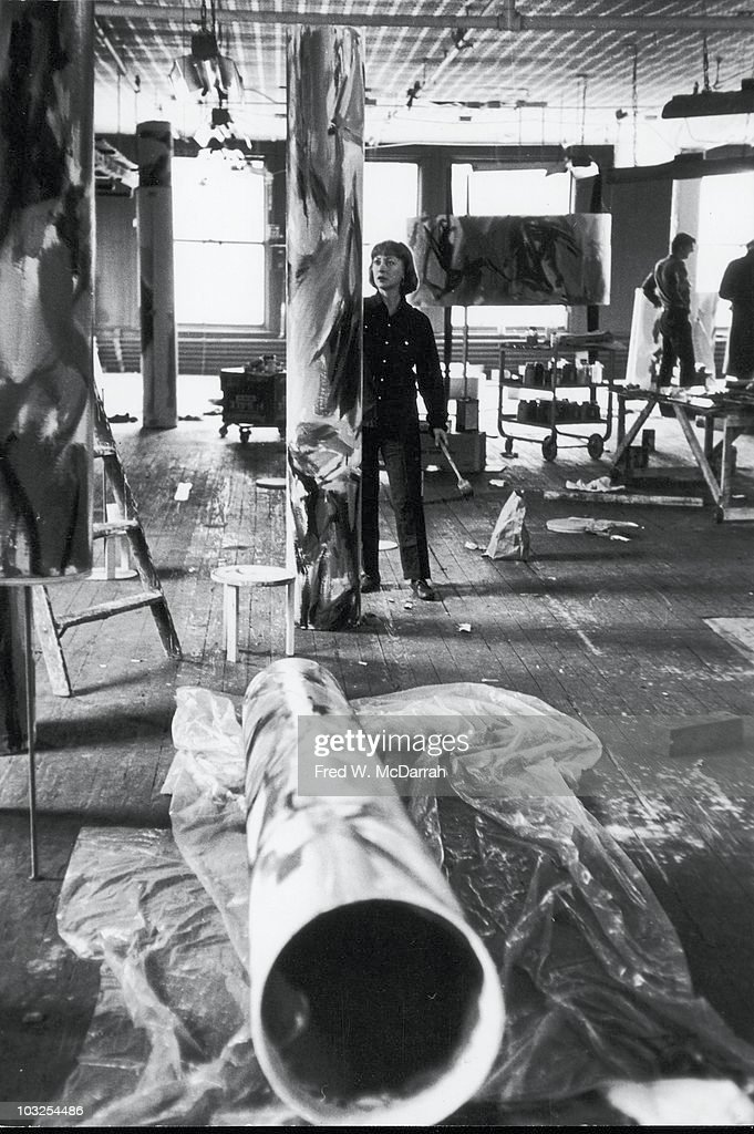 View of American artist Elaine de Kooning (1918 - 1989) as she paints on a cylindrical sculpture, New York, New York, April 6, 1961.