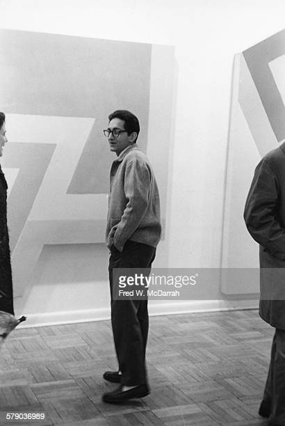 View of American artist Frank Stella as he attends an exhibit of his work at the Leo Castelli Gallery New York New York March 5 1966