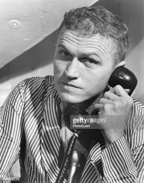 View of American astronaut Apollo 8 Commander Frank Borman as he holds telephone call on board the USS Yorktown December 27 1968 He received a...