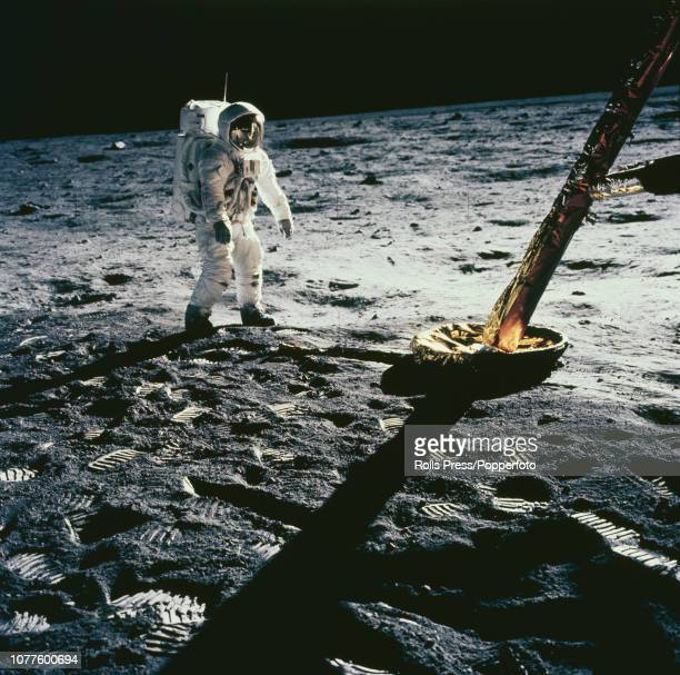 View of one of the Apollo 12 astronauts either Commander Pete Conrad or Lunar Module pilot Alan Bean standing near one leg of the Lunar Module as he...