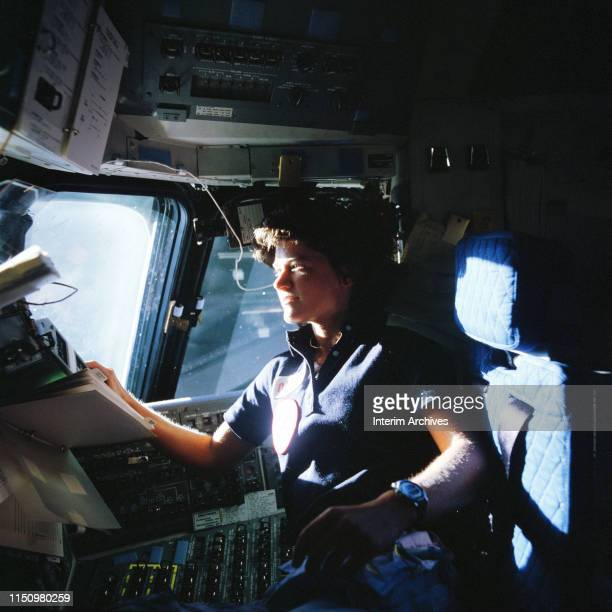 View of American astronaut Sally Ride in the cockit of the NASA space shuttle Challenger June 1983