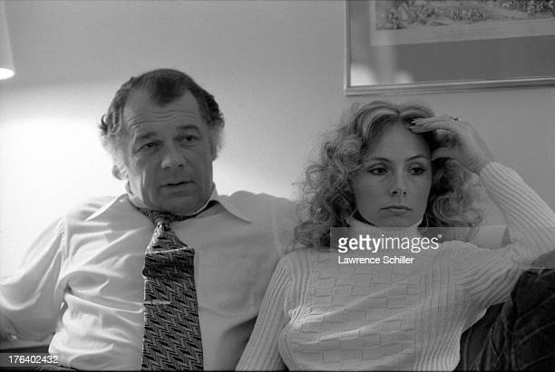 View of American attorney F Lee Bailey and his wife Lynda Hart watch television in their room at the Stanford Court hotel San Francisco California...