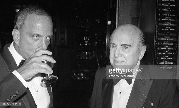 View of American attorney Roy Cohn as he stands with an unidentified elderly man during Cohn's birthday party at the Seventh Regiment Armory New York...