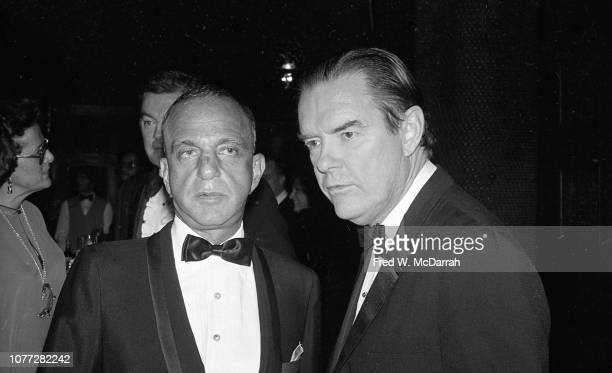 View of American attorneys and law partners Roy Cohn and Tom Bolan during Cohn's birthday party at the Seventh Regiment Armory New York New York...