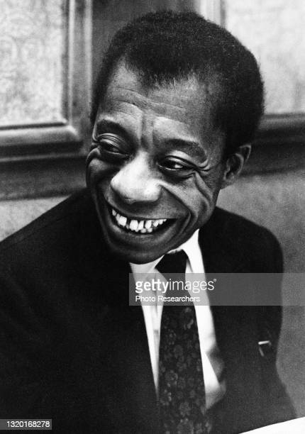 View of American author and activist James Baldwin as he smiles at the Brussels Restaurant, New York, New York, October 1967.