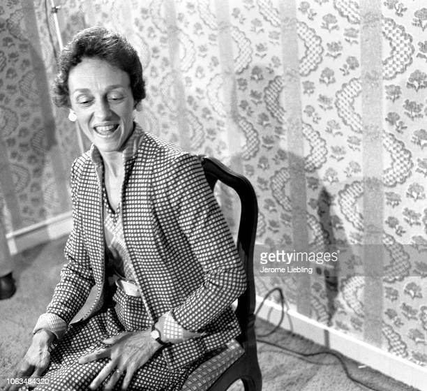 View of American author artist and arts patron Joan Mondale as she sits in a chair in a suite at the Americana Hotel New York New York July 1976 Her...