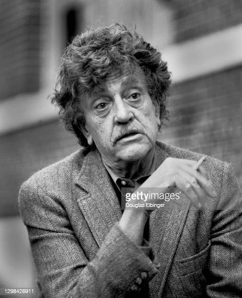 View of American author Kurt Vonnegut Jr as he smokes a cigarette outside the Michigan State University Student Union, East Lansing, Michigan, April...