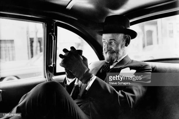 View of American author Patrick Dennis as he sits in back of a car New York New York 1963