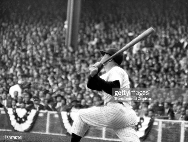 View of American baseball player Mickey Mantle of the New York Yankees swings a bat during a World Series game at Yankee Stadium New York New York...
