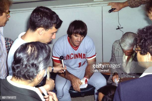 View of American baseball player Pete Rose of the Cincinatti Reds as he is interviewed in the dugout before a game at Shea Stadium in Flushing...
