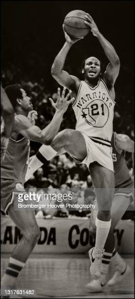 View of American basketball player World B Free , of the Golden State Warriors, jumps with the ball during a game against the Philadelphia 76ers,...