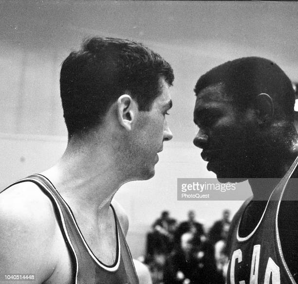 View of American basketball players Bill Bradley and Jim Barnes as they face one another during the elimination tournament game for selection of the...