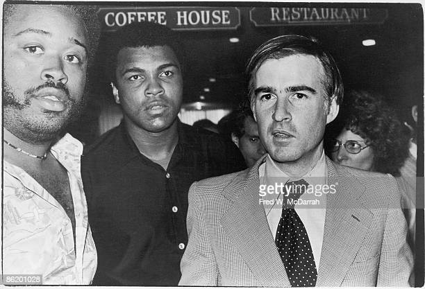 View of American boxer Muhammad Ali and California Governor Jerry Brown together near the awening of an unidentified restaurant during the latter's...
