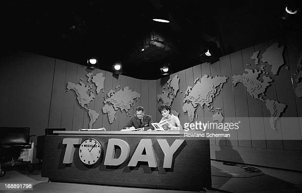 View of American broadcast journalists Hugh Downs and Barbara Walters as they sit at the desk on the 'Today' show set, New York, New York, 1966....