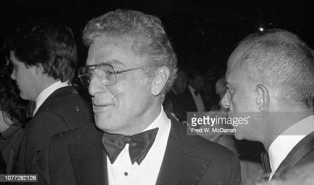 View of American businessman Victor Potamkin and attorney Roy Cohn during Cohn's birthday party at the Seventh Regiment Armory New York New York...