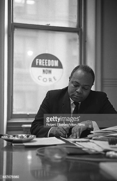 View of American Civil Rights activist James Farmer Jr cofounder of the Congress of Racial Equality as he works at a desk in his office New York 1964