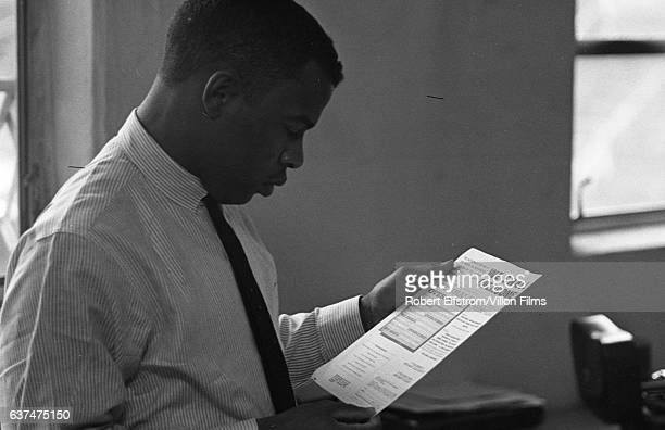 View of American Civil Rights activist John Lewis, chairman of the Student Non-Violent Coordinating Committee , in an office, New York, 1964. He...