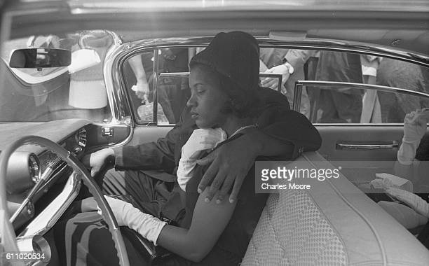 View of American Civil Rights activist Myrlie Evers in a car during the funeral procession for her husband Medgar Evers Jackson Mississippi June 15...
