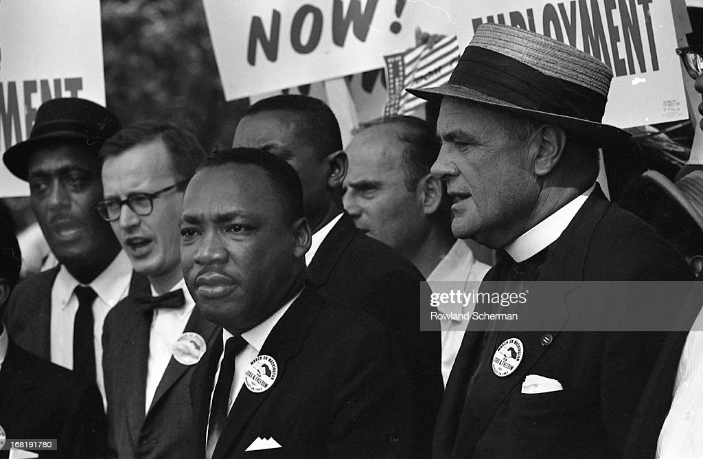 View of American civil rights leader Martin Luther King, Jr. (1929 - 1968, center) at the March on Washington for Jobs and Freedom, where he would deliver his 'I Have a Dream' speech, Washington DC, 28th August 1963.