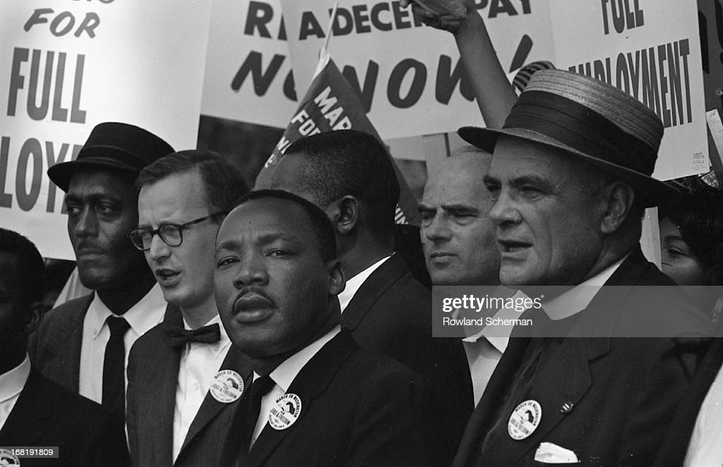 View of American civil rights leader Martin Luther King, Jr. (1929 - 1968, center) at the March on Washington for Jobs and Freedom, where he would deliver his 'I Have a Dream' speech, Washington DC, August 28, 1963.