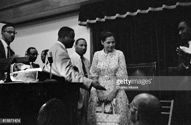 View of American Civil Rights leaders Reverend Ralph Abernathy Dr Martin Luther King Jr and Rosa Parks as they stand during an unspecified event at...