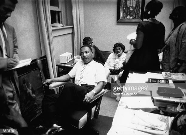 View of American clergyman and civil rights campaigner Martin Luther King Jr and others as they sit in First Baptist Church, Montgomery, Alabama, May...