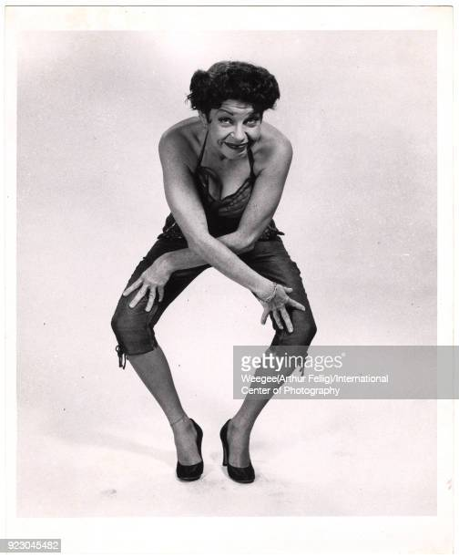 View of American comedienne and actress Martha Raye as she dances the 'Bee's Knees' against a white background twentieth century Photo by Weegee...