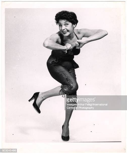 View of American comedienne and actress Martha Raye as she dances the Charleston against a white background twentieth century Photo by Weegee...
