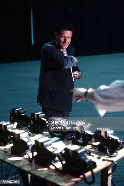View of American composer John Cage as he sets up telephones for part of his 'Variations VII' piece during '9 Evenings Theatre Engineering' at the...