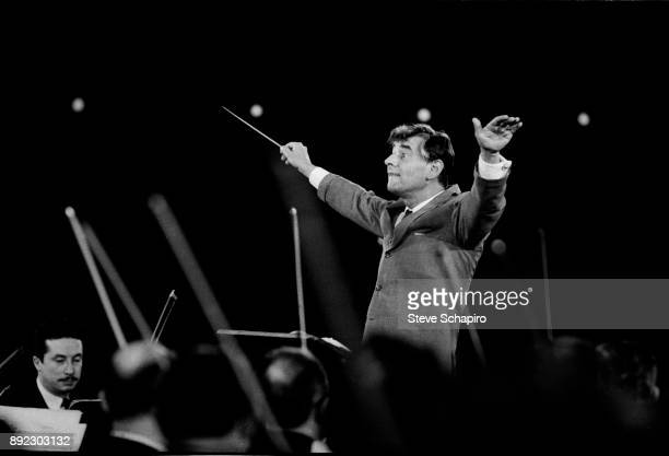 View of American composer, musician, and conductor Leonard Bernstein as he conducts a performance at Carnegie Hall, New York, New York, 1959.