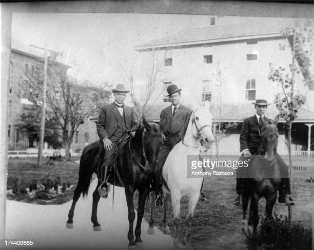 View of American educator Booker T Washington as he poses on horseback with his sons Booker T Washington Jr and Ernest Davidson Washington 1912