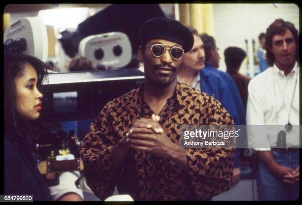 View of American film director John Singleton in sunglasses and a beret on the set of his film 'Poetic Justice' Los Angeles California 1993