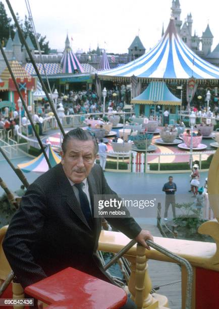 View of American film producer and studio executive Walt Disney 'aboard' the Chicken of the Sea Pirate Ship in Disneyland's Fantasyland Anaheim...